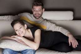 Young couple enjoying a movie at home